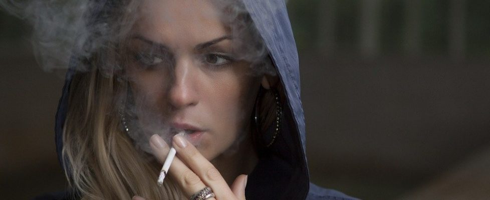 Woman smoking on the streets
